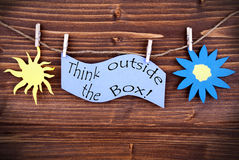 Light Blue Lable Saying Think Outside The Box Royalty Free Stock Photo