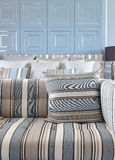 Light blue and light brown striped sofa set with classic blue wa Royalty Free Stock Images