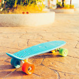 Light blue longboard penny board with multicolored wheels ready Stock Photography