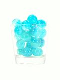 Light Blue Marbles In A Glass Royalty Free Stock Photos