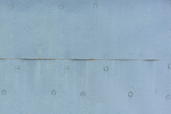 Light Blue Metal Texture with Rivets Royalty Free Stock Images