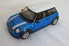 Light blue Mini Cooper car 2013 version Stock Image