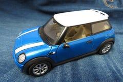 Light blue Mini Cooper car 2013 version Stock Photography
