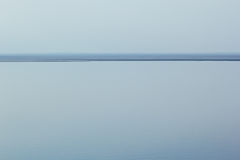 Light blue minimalist landscape with a horizon line. Copy space. Royalty Free Stock Image