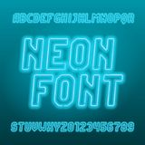 Light blue neon tube alphabet font. Neon color oblique letters, numbers and symbols. Stock vector typeset for your typography design royalty free illustration