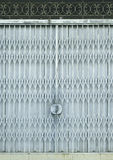 Light blue old metal grille sliding door Royalty Free Stock Photo