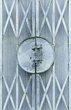 Light blue old metal grille sliding door Stock Photography