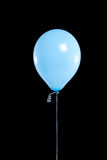 Light blue Party balloon on black Stock Photography