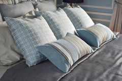Light blue pillows in difference pattern with classic bedding. Light blue pillows in difference pattern with classic style bedding stock photography