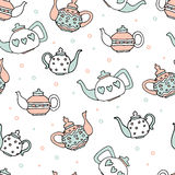 Light blue and pink colored set of four cute teapots Royalty Free Stock Images
