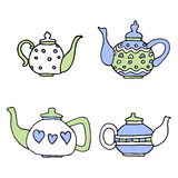 Light blue and pink colored, set of four cute teapots Royalty Free Stock Photos