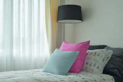Light blue and pink pillow on single bed size Royalty Free Stock Photography