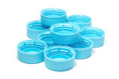 Light blue plastic bottle caps Stock Image