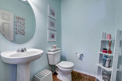 Light blue restroom with shelf Royalty Free Stock Photography