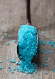 Light blue salt in a spoon. Royalty Free Stock Images