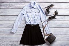 Light blue shirt and heels. Royalty Free Stock Photos