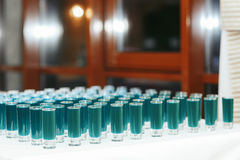 Light blue shots on the white table. A Stock Photos