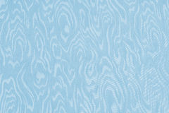 Light blue silk damask fabric with moire pattern Royalty Free Stock Images