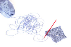 Free Light Blue Skein Of Acrylic Thread With The Unwound String, Square Crochet Element And Red Hook Stock Photo - 55056590