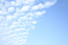 Light blue sky with clouds Royalty Free Stock Photos