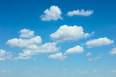 Light blue sky and white clouds background Royalty Free Stock Images