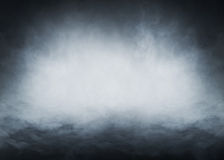 Light blue smoke on a black background. Halloween concept image Royalty Free Stock Photo