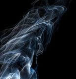 Light blue smoke isolated on black Stock Photography