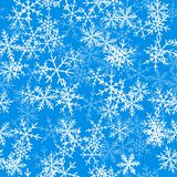 Light blue snowflakes pattern on blue Christmas. Light blue snowflakes pattern on blue Christmas background. Chaotic scattered light blue snowflakes. Splendid Royalty Free Stock Photo