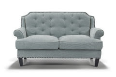 Light blue sofa, front view. Blue grey sofa with shadow isolated on white background Royalty Free Stock Photography