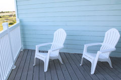 Light blue terrace and white chairs. Royalty Free Stock Photo