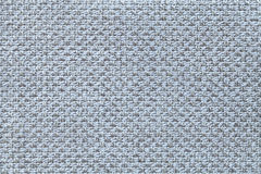 Light blue textile background with checkered pattern, closeup. Structure of the fabric macro. Stock Photo