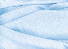 Light blue towel. A delicate light blue cotton fabric with many folds. Ther is the pink version too Royalty Free Stock Photo