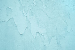 Light blue or turquoise old wall with exfoliated color. Stock Photos