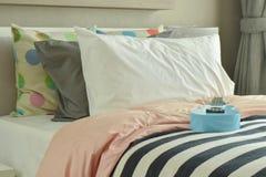 Light blue ukulele on striped bedding. Lively bedroom with light blue ukulele on striped bedding Stock Image
