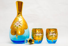 Light blue Venetian glass set. Glass jug and goblets handmade in Venice. Light blue tints with floral and gold leaf adornments Stock Photography