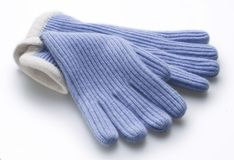 Light blue woolen gloves. Over white Stock Photography