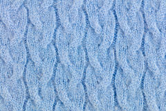 Light Blue woolen knitted ornamented fabric background Stock Photos