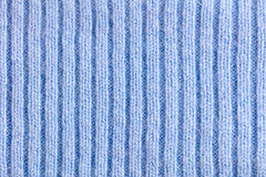 Light Blue woolen knitted striped fabric texture Stock Image