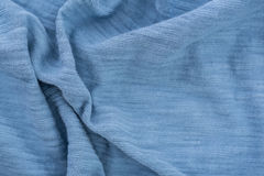 Light blue wrinkled fabric. Stock Images