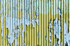 Light blue and yellow paint with scratch on the galvanized iron Royalty Free Stock Photo