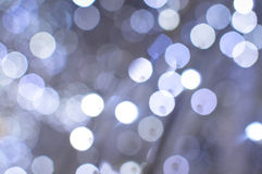 Light blurred background with white bokeh lights Stock Image