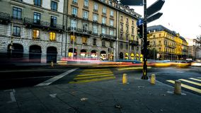 Light blurs of people and traffic on busy city urban streets Stock Photography