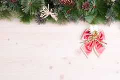Light board with pine needles and cones Christmas toys and Chris Stock Photos