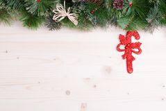 Light board with pine needles and cones Christmas toys and Chris Stock Images