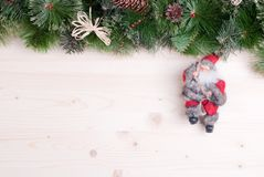 Light board with pine needles and cones Christmas toys and Chris Royalty Free Stock Images