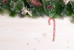 Light board with pine needles and cones Christmas toys and Chris Royalty Free Stock Photos