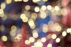 Light bokeh light reflection background. Festive background with natural bokeh and bright golden lights. Vintage Magic background with colorful bokeh. Spring Stock Photo