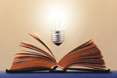 Light on the book symbolizes the idea Royalty Free Stock Photo