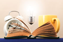 Light on the book symbolizes the idea Stock Images