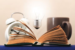 Light on the book symbolizes the idea Royalty Free Stock Photos